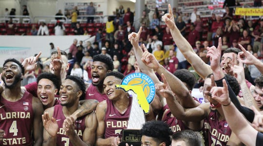 The Florida State basketball team celebrates their 63-60 overtime win against Purdue in the championship game at the Emerald Coast Classic in Niceville, Fla., Saturday, November 30, 2019. [MICHAEL SNYDER/DAILY NEWS]
