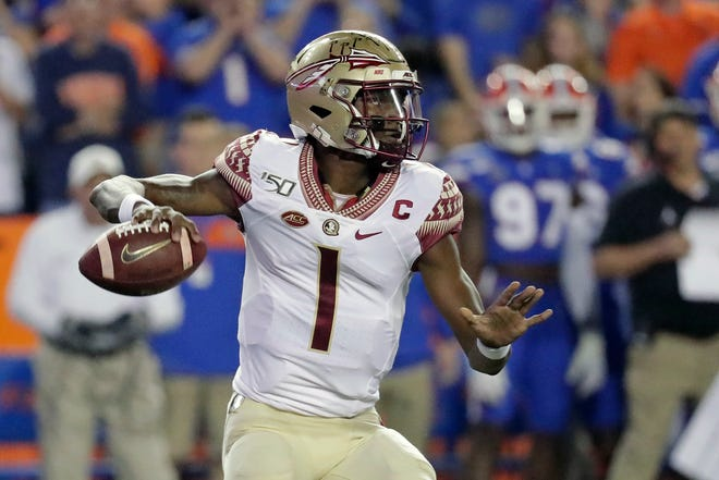 Florida State quarterback James Blackman looks for a receiver during the first half of the team's NCAA college football game against Florida, Saturday, Nov. 30, 2019, in Gainesville, Fla. (AP Photo/John Raoux)