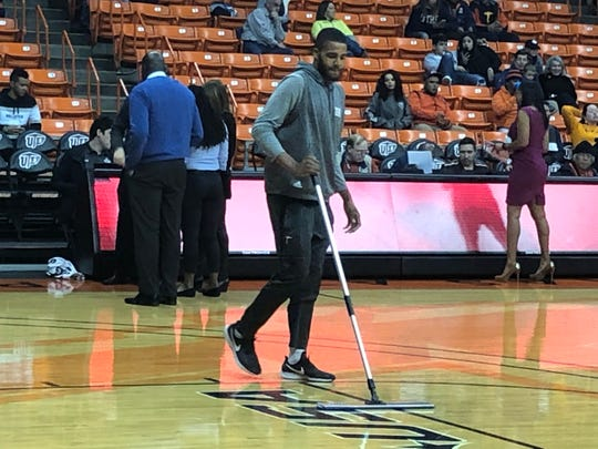 Efe Odigie, center for the UTEP men's basketball team, mops the floor during Saturday's game between New Mexico State and Western Michigan Saturday night at the Don Haskins Center