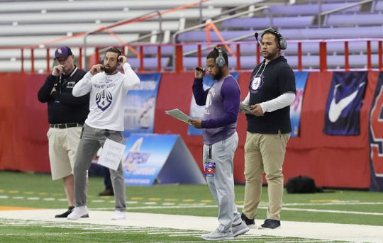 New Rochelle appointed Ray Rhett (center) as its new varsity football coach. Rhett is pictured during the 2019 Class AA state championship game at the Carrier Dome in Syracuse.