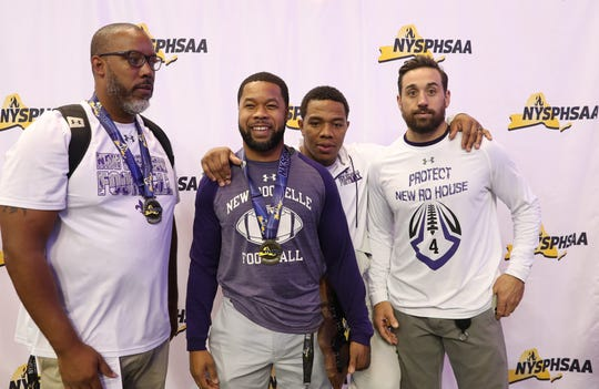 New Rochelle tabbed Ray Rhett (second from left) as its new varsity football coach.