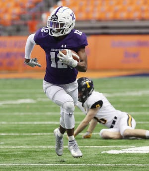 New Rochelle's Jessie Parson (12) looks for some running room in the McQuaid defense during the NYSPHSAA Class AA state championship at the Carrier Dome in Syracuse Nov. 30, 2019. New Rochelle won the game 28-0.
