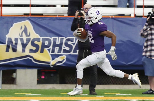 New Rochelle's Jessie Parson (12) heads for the end zone against McQuaid during the NYSPHSAA Class AA state championship at the Carrier Dome in Syracuse Nov. 30, 2019. New Rochelle won the game 28-0.