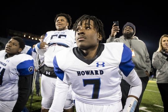 Howard's Donovan Cartwright listens to head coach Dan Ritter after winning the DIAA Division II state championship Saturday at Delaware Stadium.
