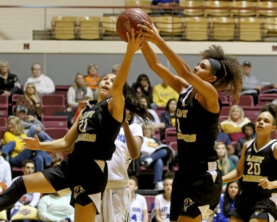 Rider's Ashlynn Knight (21) and Jalynn Bristow grab the rebound in the game against Palo Duro at the Fantasy of Lights tournament Saturday, Nov. 30, 2019, at Midwestern State University's D.L. Ligon Coliseum.