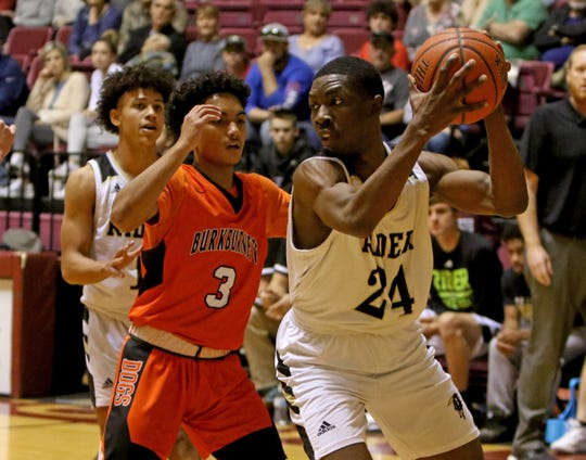 Rider's Dashawn Jefferson looks to pass while guarded by Burkburnett's Jaevion Moreland at the Fantasy of Lights tournament Saturday, Nov. 30, 2019, at Midwestern State's D.L. Ligon Coliseum.