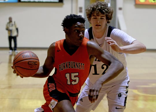 Burkburnett's Doriean Smith drives to the basket by Rider's Parker Newsome at the Fantasy of Lights tournament Saturday, Nov. 30, 2019, at Midwestern State's D.L. Ligon Coliseum.
