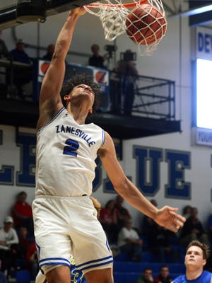 Jalen Moeller-Kile throws down a dunk during the fourth quarter of Zanesville's 59-58 win against Maysville on Saturday night in the consolation game of the Tip-Off Classic at Winland Memorial Gymnasium.
