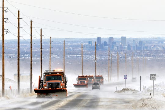 Snow plows remove snow from Colorado Highway 72, near Denver, Colorado on November 30,  2019, in an effort to keep the highways clear of blowing and drifting snow. Holiday snow storms left as much as two feet of snow in some parts of the Denver area. High winds and drifting snow forced highway officials to close many roads.