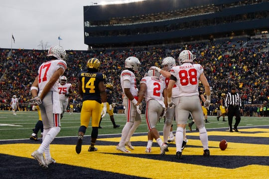 Winners and losers from Week 14 in college football led by Ohio State, Michigan, Auburn