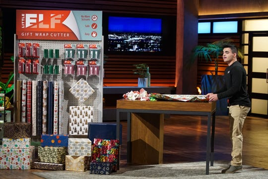 """Bryan Perla, an entrepreneur from West Boylston, Massachusetts, introduces his innovative tool to make holiday gift-wrapping easier to the sharks on """"Shark Tank."""""""