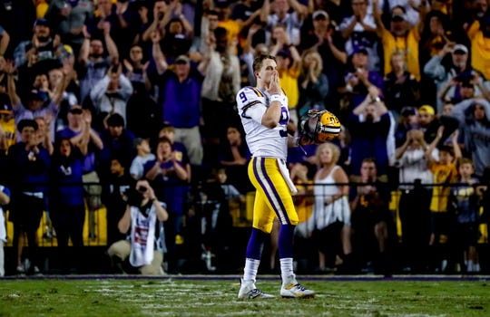 LSU Tigers quarterback Joe Burrow waves to the crowd as he is pulled from the game against the Texas A&M Aggies during the second half at Tiger Stadium on Nov. 30, 2019.