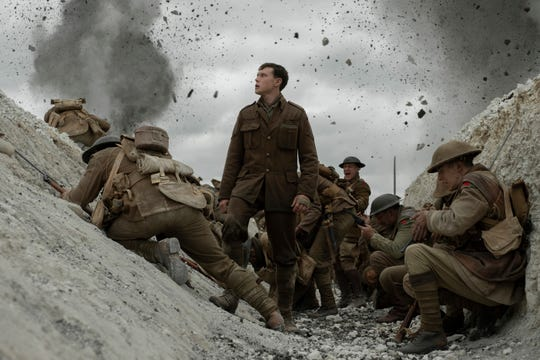 "George MacKay (center) stars as a young British soldier who has to relay an important message in the World War I movie ""1917."""