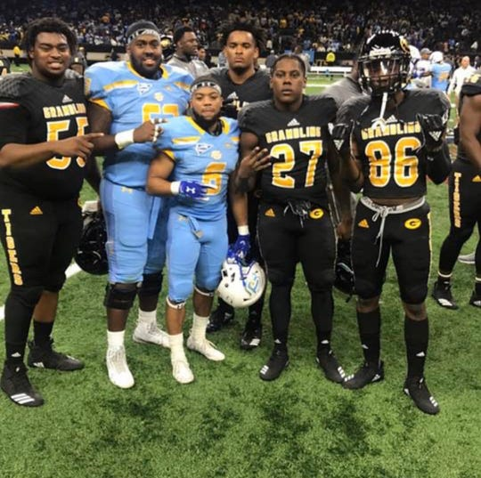 Former Peabody football players gather after last year's Bayou Classic. From left are: Linwood Banks, Chris Nash, Jamar Washington, Martavius Dotson, Justin Richard and DeQuarius Thomas.