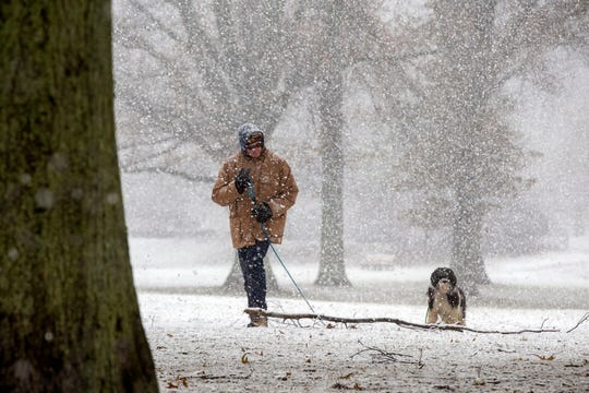 Roland Eckstein of Middletown walks his dog, Sadie Bear, in the snow at Holmdel Park in Holmdel, NJ Monday December 2, 2019.