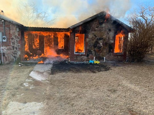 Fire engulfs a house in the 100 block of Yucca Lane in Sweetwater on Monday, Dec. 2, 2019.