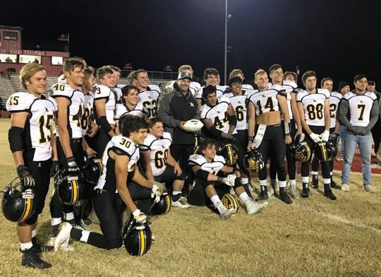 Cisco coach Brent West, center, poses with his players after picking up career win No. 200 on Friday, Nov. 1, 2019, at Tiger Stadium in Anson.