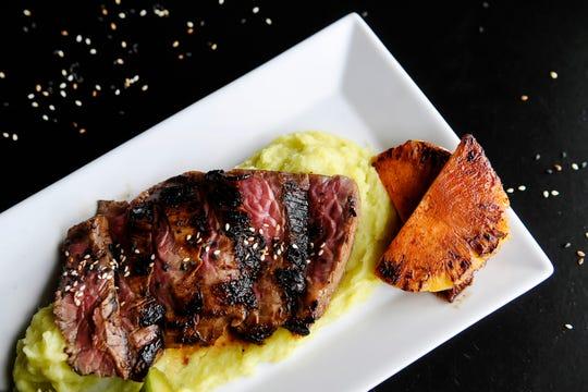 RosaBees' Teri beef has thin slices of flank steak, marinated in teriyaki with wasabi satsuma mash.