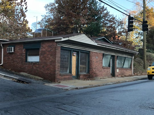 This building at 500 Biltmore Ave., across from the Mission Hospital campus, was donated to Asheville Area Habitat for Humanity. Over the years it has been a pharmacy, a cafe and a floral shop.