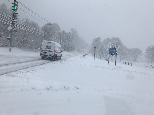 Snow covers Vestal Avenue in Binghamton, looking west from MacArthur Elementary School, on Dec. 2, 2019.