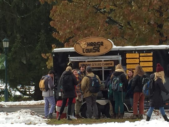 Customers line up at the Cheese Louise food cart at the University of Vermont on Nov. 21, 2019.