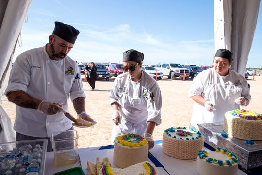 Del Mar College culinary arts students Gilbert Flores, from left, Jenna Davis, and Elizabeth Molina serve up cakes crafted by students from the college during a celebration of the beginning of construction on the college's Southside campus on Monday, December 2, 2019. Three centers of excellence were identified for the new campus, one of which includes hospitality and culinary arts.