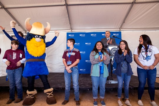 High school students from around the area participate in the Viking Clap led by Valdor the Viking during a celebration of construction beginning on Del Mar College's new Southside campus on Monday, December 2, 2019.