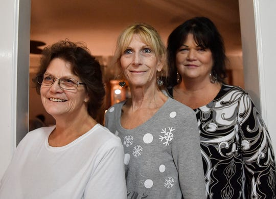 From left to right, sisters Pat Norcross, Lisa Martin and Sharon Smith gather during an old-fashioned caroling and cocoa event to start the Christmas season on Sunday, December 1, 2019.