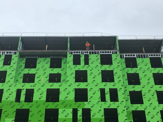 A worker helps prepare a 180-room hotel now under construction on Camden's Waterfront.