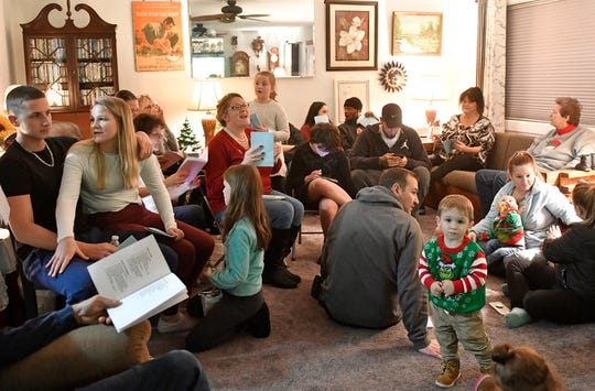 The Norcross family of South Jersey gets together for an old-fashioned caroling and cocoa event. Pat Norcross hosts the gathering that includes four generations of family members on Sunday, December 1, 2019.