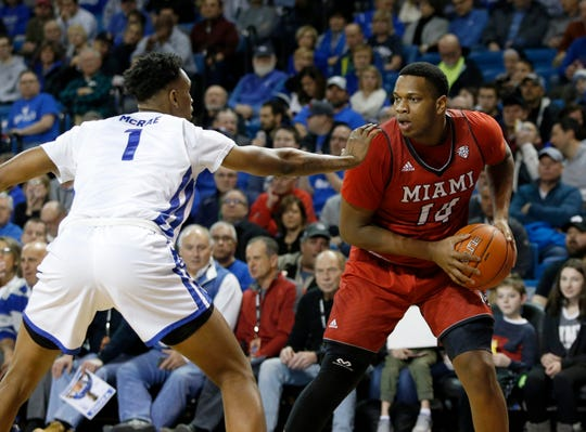 Jan 12, 2019; Buffalo, NY, USA; Miami RedHawks forward Bam Bowman (14) looks to make a pass as Buffalo Bulls forward Montell McRae (1) defends during the second half at Alumni Arena.