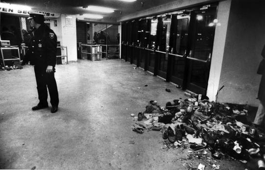 DECEMBER 3, 1979: The Who Tennis shoes, shirts, jackets and other personal belongings, dropped in the stampede on the arena doors, were swept into a pile inside the empty coliseum lobby.