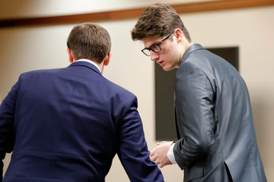 Joseph Eubank enters Kenton County Circuit Court in Covington, Ky., for his arraignment on Monday, Dec. 2, 2019. The 17-year-old former Covington Catholic High School student will be tried as an adult in a rape case,on one count of rape in the first degree and three counts of sexual abuse in the first degree.