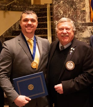 Tim Arnold, left, 2019 national Jefferson Award winner, with Bill Shula at the local award ceremony in Cincinnati.
