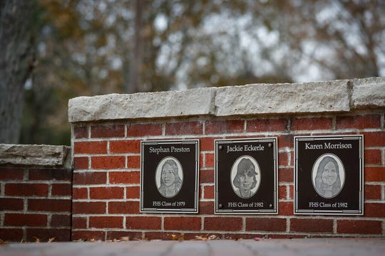 In this Thursday, Nov. 21, 2019 photo, the faces of the three Finneytown students killed in a stampede at The Who's Dec. 3, 1979 concert, are displayed as part of a memorial at the Finneytown High School secondary campus in Finneytown, Ohio.