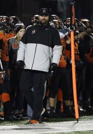 Massillon coach Nate Moore walks the sidelines during the Tigers' state-semifinal win over Avon.