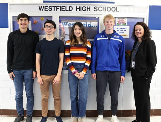 Westfield High School principal Mary Asfendis (far right) congratulates seniors (L-R) Brad Hornbeck, Stephen Park, Angela Wang, and Jeremy Kronheimer for their perfect scores of 800 on the Math Level 2 portion of the October SATs.