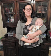 Melissa McCloy holds her 4-month-old son, Sabastian Wethy. Sabastian suffers from shaken baby syndrome and continues to battle seizures and other ailments. Fundraisers are planned to help with Sabastian's medical bills.