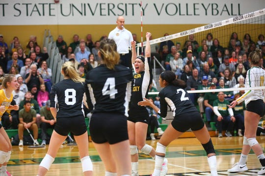 Northern Kentucky senior Laura Crawford, a Ridgewood alum, celebrates a point with her teammates during a match earlier this season. The Norse will compete in the NCAA tournament on Friday.