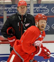 Red Wings forward Johan Franzen yells for the puck as he skates by coach Mike Babcock during practice on May 14, 2013, at Joe Louis Arena.