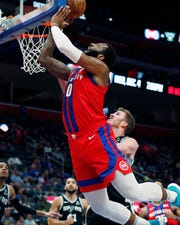 Pistons center Andre Drummond (0) attempts a layup during the second half Dec. 1, 2019, in Detroit.