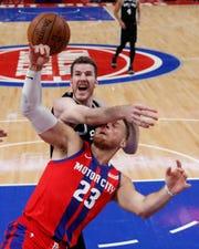 Spurs' Jakob Poeltl fouls Pistons' Blake Griffin, Dec. 1, 2019, in Detroit.