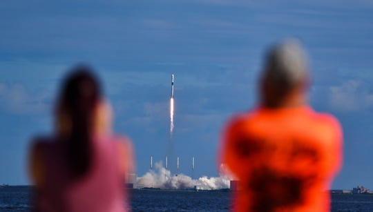 Julie and Doc Todd watch the launch SpaceX from KARS Park in Florida, Monday, Nov. 11, 2019.