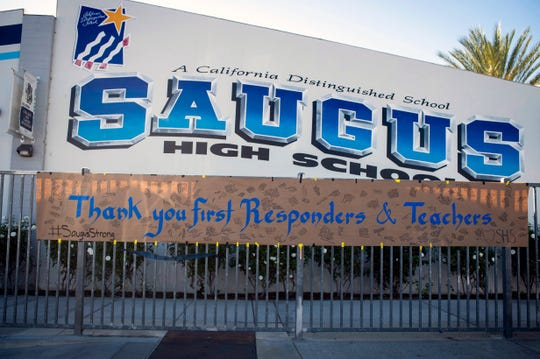 A sign thanking first responders and teachers hangs, Monday, Nov. 18, 2019, after two students were killed during a shooting at Saugus High School in Santa Clarita, Calif., several days earlier.