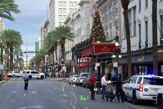 New Orleans police investigate the scene of a shooting Sunday, Dec. 1, 2019, on the edge of the city's famed French Quarter.