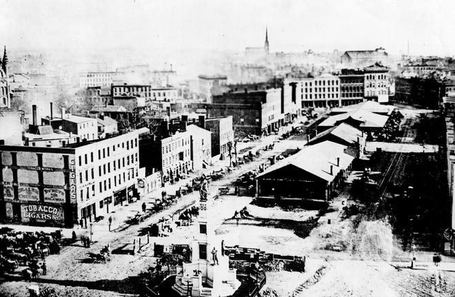 An 1872 view of Cadillac Square, facing eastward, shows the collection of market stalls lined up behind the new Soldiers' and Sailors' Monument, dedicated that year.