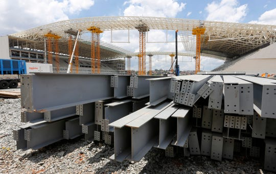 In this Dec. 8, 2013 file photo, steel beams sit outside Arena de Sao Paulo in Sao Paulo, Brazil.