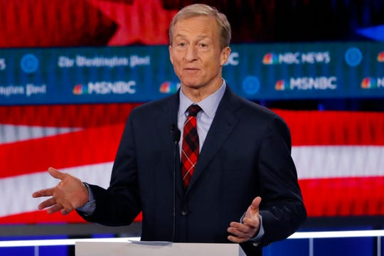 Democratic presidential candidate investor Tom Steyer speaks during a Democratic presidential primary debate in Atlanta. Democrats are narrowing Donald Trump's early spending advantage, with two billionaire White House hopefuls joining established party groups to target the president in key battleground states that are likely to determine the outcome of next year's election.