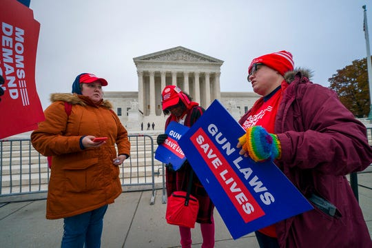 Activists gather outside the Supreme Court before the justices hear arguments in a case brought by gun owners in New York City, on Capitol Hill in Washington, Monday, Dec. 2, 2019. Advocates of gun control worry that the court's conservative majority could use the case to call into question restrictions across the country.