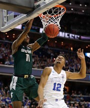 Aaron Henry (11) and Michigan State clipped Javin DeLaurier (12) and Duke in last season's East Region final.